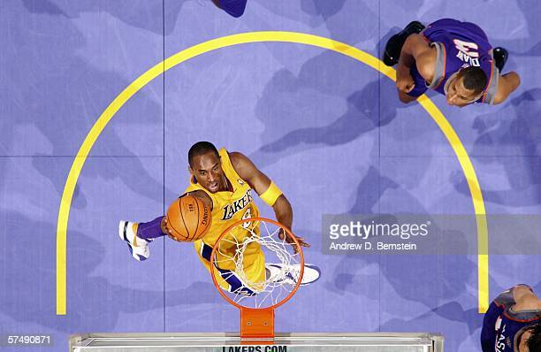 Kobe Bryant of the Los Angeles Lakers dunks against the Phoenix Suns in game three of the Western Conference Quarterfinals during the 2006 NBA...