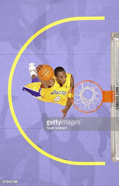 Kobe Bryant of the Los Angeles Lakers dunks against the Portland Trail Blazers on April 14 2006 at Staples Center in Los Angeles California The...
