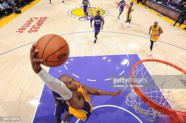 Kobe Bryant of the Los Angeles Lakers dunks against the Sacramento Kings on December 9 2014 at STAPLES Center in Los Angeles California NOTE TO USER...