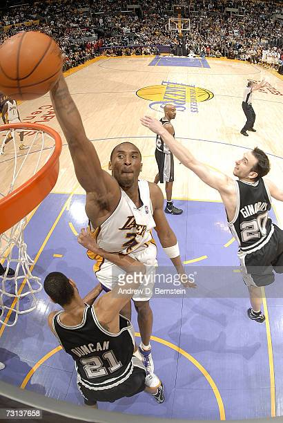Kobe Bryant of the Los Angeles Lakers dunks against Tim Duncan and Manu Ginobili of the San Antonio Spurs on January 28 2007 at Staples Center in Los...