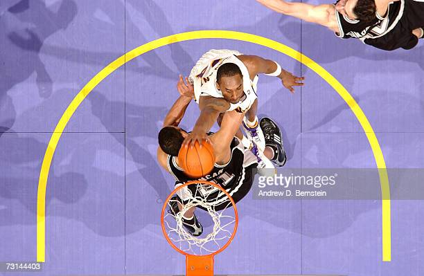 Kobe Bryant of the Los Angeles Lakers dunks against Tim Duncan of the San Antonio Spurs on January 28 2007 at Staples Center in Los Angeles...