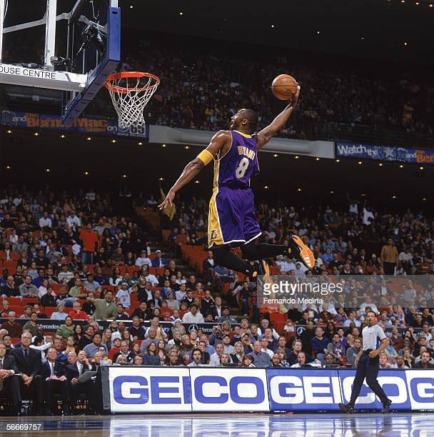 Kobe Bryant of the Los Angeles Lakers dunks during a game against the Orlando Magic at TD Waterhouse Centre on December 23 2005 in Orlando Florida...
