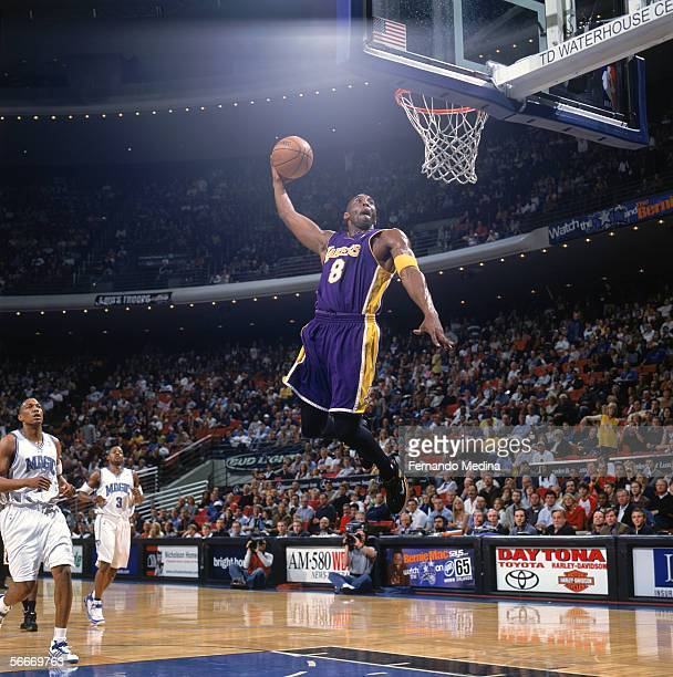 Kobe Bryant of the Los Angeles Lakers dunks during a game against the Orlando Magic at TD Waterhouse Centre on December 23, 2005 in Orlando, Florida....