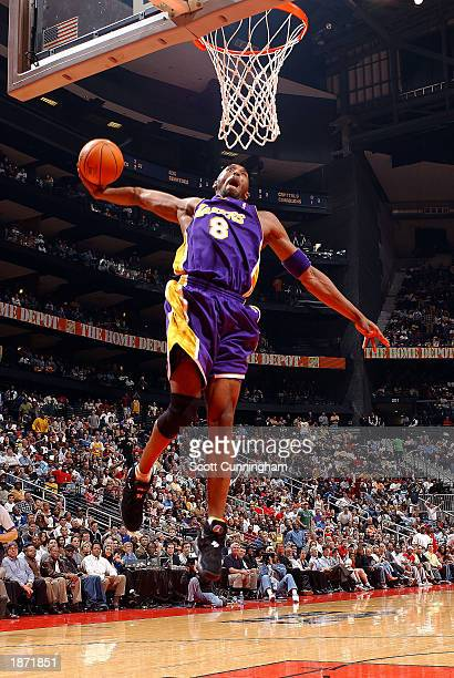 Kobe Bryant of the Los Angeles Lakers dunks during a game at Philips Arena on March 25 2003 in Atlanta Georgia NOTE TO USER User expressly...