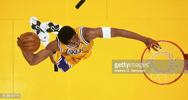 Kobe Bryant of the Los Angeles Lakers dunks during a game circa 1999 at the Great Western Forum in Inglewood, California. NOTE TO USER: User...