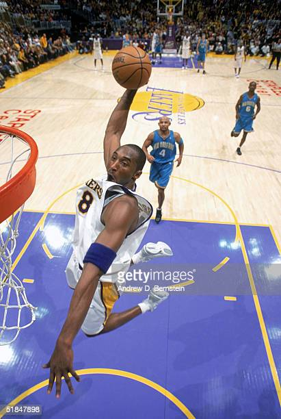Kobe Bryant of the Los Angeles Lakers dunks during the game against the New Orleans Hornets at Staples Center on November 28 2004 in Los Angeles...