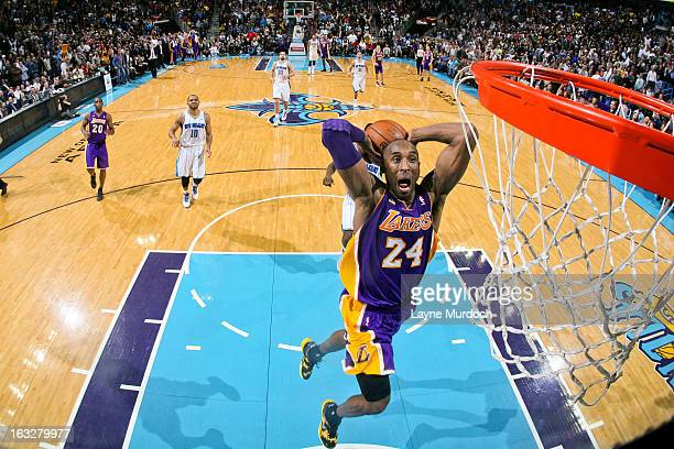 Kobe Bryant of the Los Angeles Lakers dunks on a fast break against the New Orleans Hornets on March 6, 2013 at the New Orleans Arena in New Orleans,...