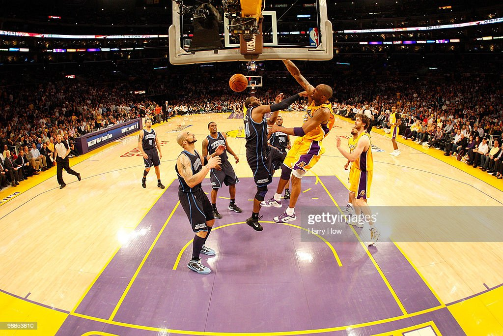 Kobe Bryant #24 of the Los Angeles Lakers dunks over C.J. Miles #34 of the Utah Jazz in the fourth quarter during Game Two of the Western Conference Semifinals of the 2010 NBA Playoffs at Staples Center on May 4, 2010 in Los Angeles, California.