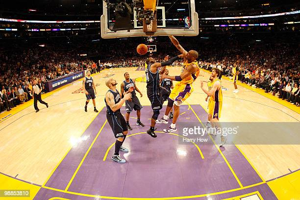 Kobe Bryant of the Los Angeles Lakers dunks over CJ Miles of the Utah Jazz in the fourth quarter during Game Two of the Western Conference Semifinals...