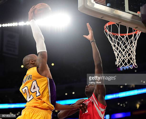 Kobe Bryant of the Los Angeles Lakers dunks over Clint Capela of the Houston Rockets during a 107-87 Rockets win at Staples Center on December 17,...