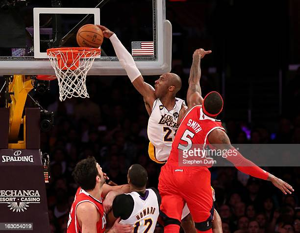 Kobe Bryant of the Los Angeles Lakers dunks over Josh Smith of the Atlanta Hawks at Staples Center on March 3, 2013 in Los Angeles, California. The...