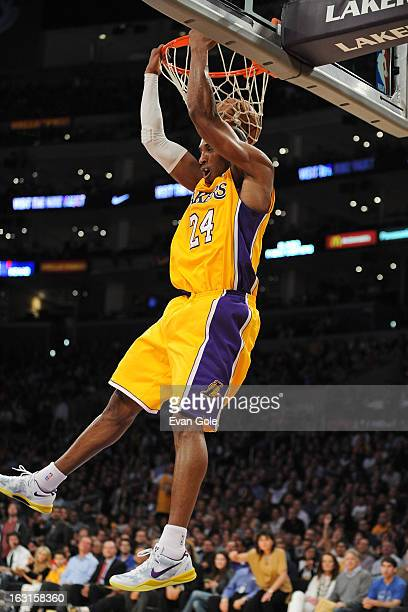 Kobe Bryant of the Los Angeles Lakers dunks the ball against the Minnesota Timberwolves at Staples Center on February 28 2013 in Los Angeles...