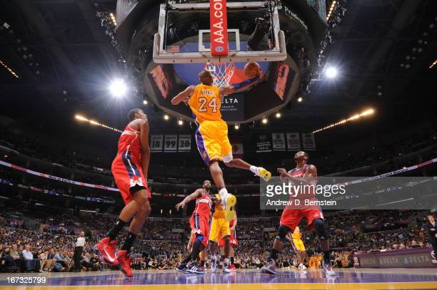 Kobe Bryant of the Los Angeles Lakers dunks the ball against the Washington Wizards at Staples Center on March 22, 2013 in Los Angeles, California....