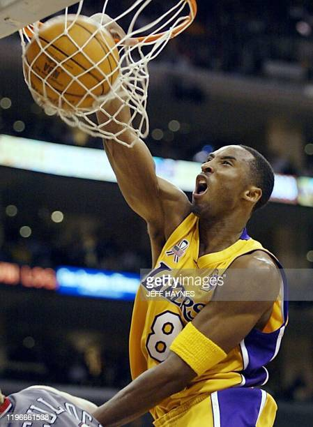 Kobe Bryant of the Los Angeles Lakers dunks the ball against the New Jersey Nets in the 3rd quarter of game one of the NBA Finals against 05 June...