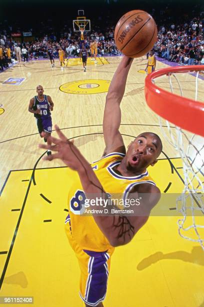 Kobe Bryant of the Los Angeles Lakers dunks the ball against the Sacramento Kings on January 3 1997 at the Great Western Forum in Inglewood...