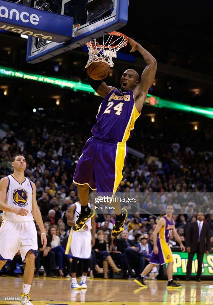 Kobe Bryant #24 of the Los Angeles Lakers dunks the ball during their game against the Golden State Warriors at Oracle Arena on December 22, 2012 in Oakland, California.