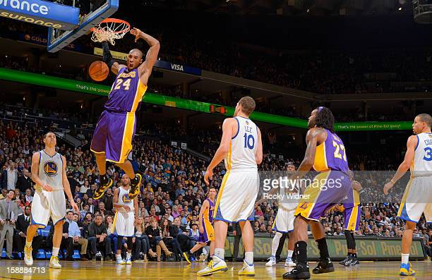 Kobe Bryant of the Los Angeles Lakers dunks the ball in against David Lee and Klay Thompson of the Golden State Warriors on December 22 2012 at...