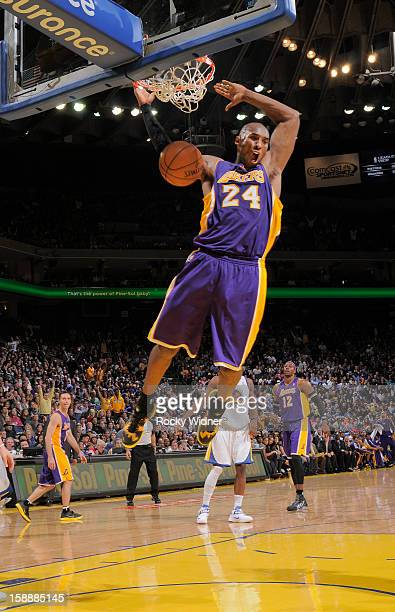 Kobe Bryant of the Los Angeles Lakers dunks the ball in against the Golden State Warriors on December 22 2012 at Oracle Arena in Oakland California...