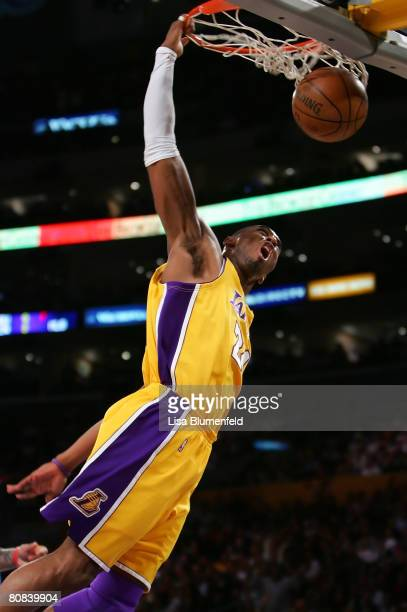 Kobe Bryant of the Los Angeles Lakers dunks the ball in the first quarter against the Denver Nuggets in Game Two of the Western Conference...