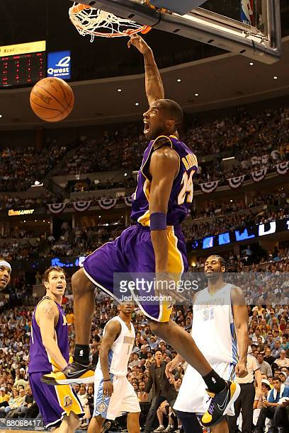 Kobe Bryant of the Los Angeles Lakers dunks the ball in the second half against the Denver Nuggets in Game Six of the Western Conference Finals...