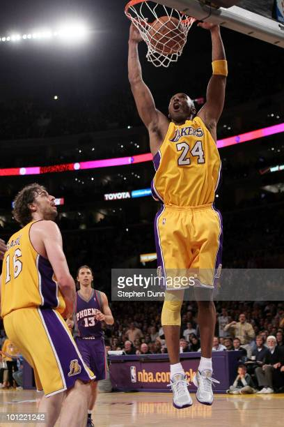 Kobe Bryant of the Los Angeles Lakers dunks the ball in the third quarter of Game Five of the Western Conference Finals against the Phoenix Suns...