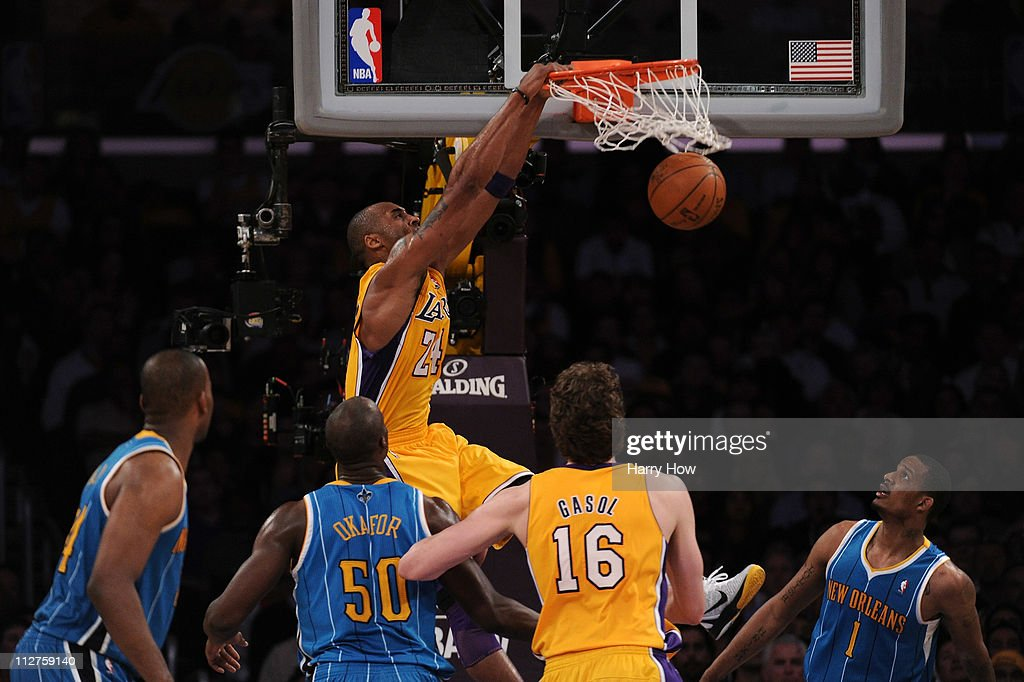 Kobe Bryant #24 of the Los Angeles Lakers dunks the ball over Emeka Okafor #50 of the New Orleans Hornets in the fourth quarter in Game Two of the Western Conference Quarterfinals in the 2011 NBA Playoffs on April 20, 2011 at Staples Center in Los Angeles, California.