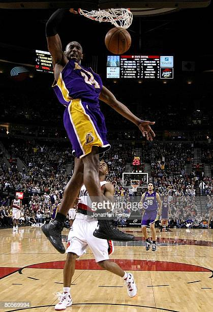 Kobe Bryant of the Los Angeles Lakers dunks the ball over Jarrett Jack the Portland Trail Blazers at the Rose Garden on April 8 2008 in Portland...