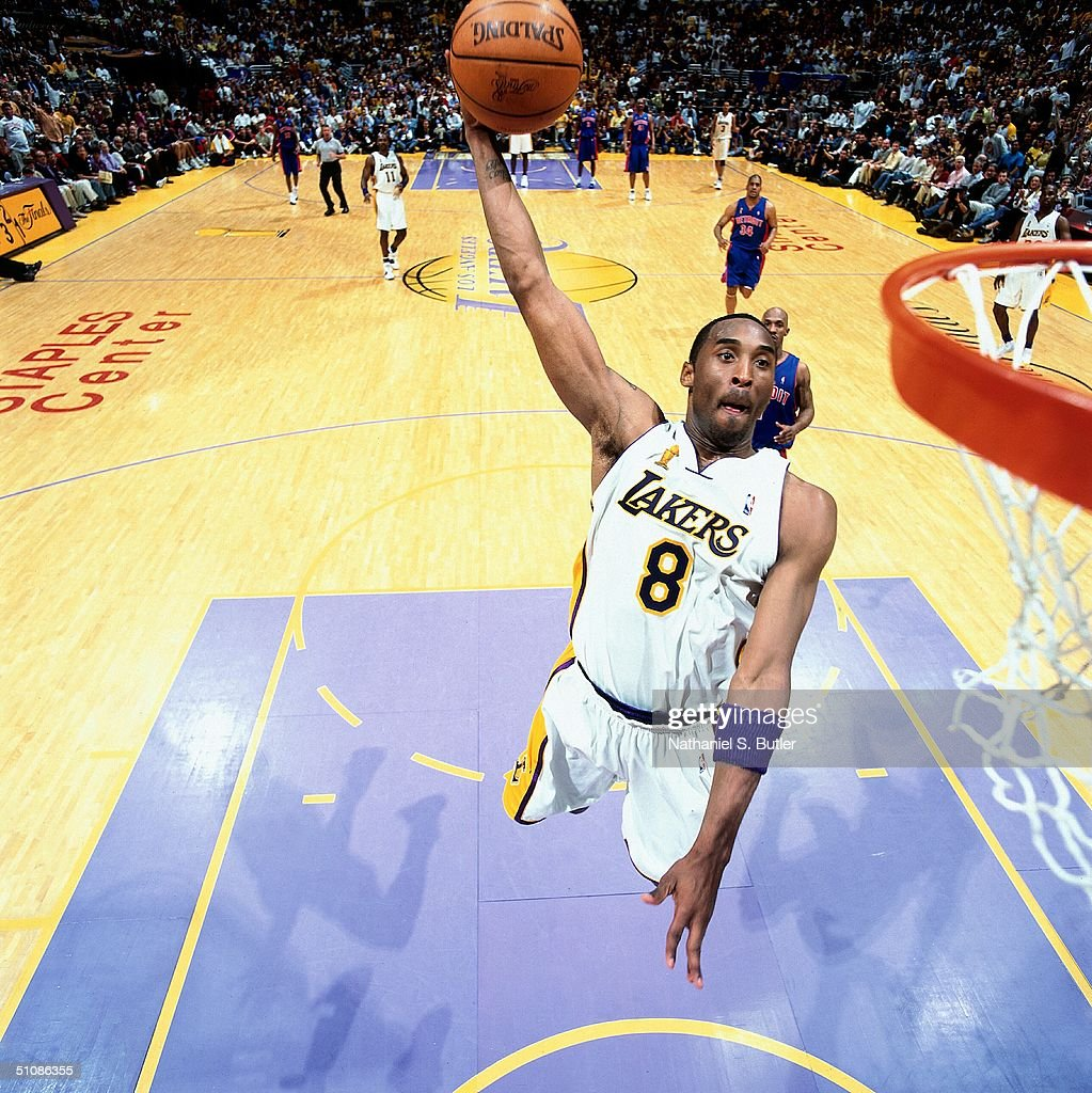 Kobe Bryant Of The Los Angeles Lakers Dunks The Ball Past