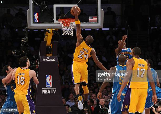 Kobe Bryant of the Los Angeles Lakers dunks the ball with his left hand in the lane in the third quarter against the New Orleans Hornets in Game Five...