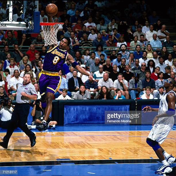 Kobe Bryant of the Los Angeles Lakers elevates for a dunk against Horace Grant of the Orlando Magic at the Orlando Arena in Orlando Florida NOTE TO...