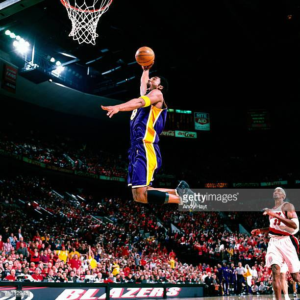 Kobe Bryant of the Los Angeles Lakers elevates for a dunk against the Portland Trail Blazerz during a game in 2000 at the Rose Garden in Portland...