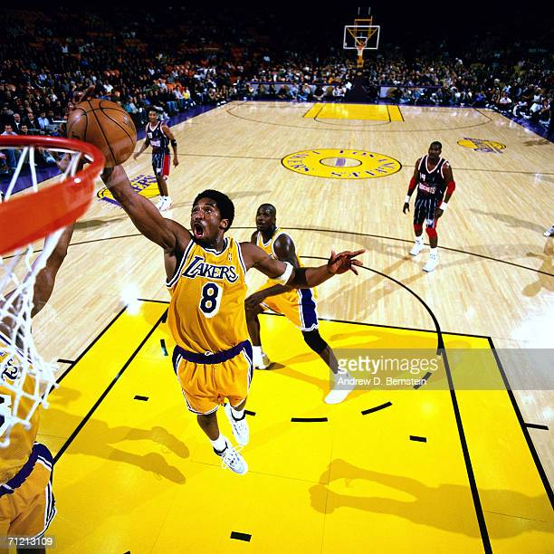 Kobe Bryant of the Los Angeles Lakers elevates for a dunk against the Houston Rockets at The Great Western Forum in Inglewood California NOTE TO USER...