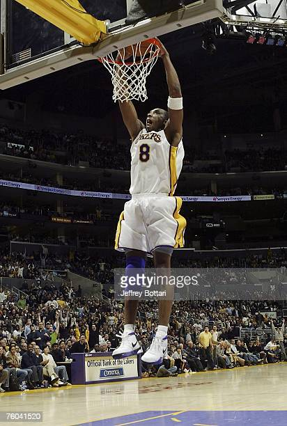 Kobe Bryant of the Los Angeles Lakers elevates for a dunk against the Toronto Raptors during his 81 point explosion on January 22, 2006 at Staples...