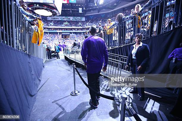 Kobe Bryant of the Los Angeles Lakers enters the court before the game against the Charlotte Hornets on December 28 2015 at Time Warner Cable Arena...
