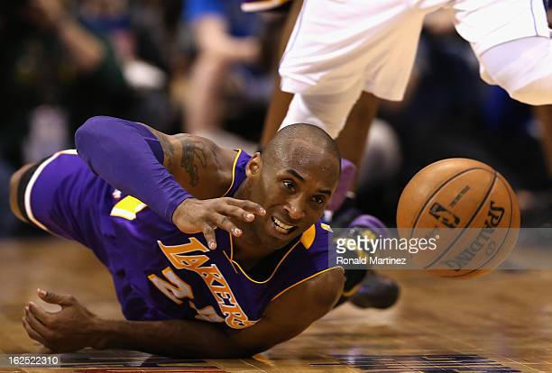 Kobe Bryant of the Los Angeles Lakers falls after fouled by OJ Mayo of the Dallas Mavericks at American Airlines Center on February 24 2013 in Dallas...