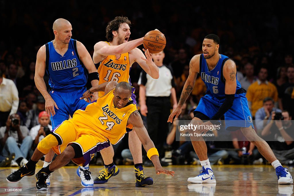 Kobe Bryant #24 of the Los Angeles Lakers falls down as Pau Gasol #16 looses the ball in front of Jason Kidd #2 and Tyson Chandler #6 of the Dallas Mavericks late in the fourth quarter in Game One of the Western Conference Semifinals in the 2011 NBA Playoffs at Staples Center on May 2, 2011 in Los Angeles, California.