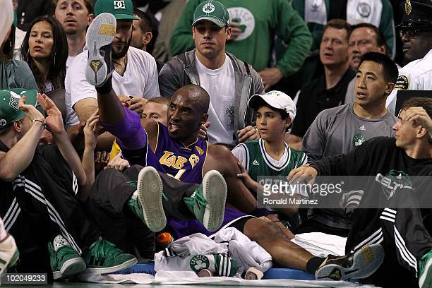 Kobe Bryant of the Los Angeles Lakers falls into the crowd in the second quarter against the Boston Celtics during Game Five of the 2010 NBA Finals...