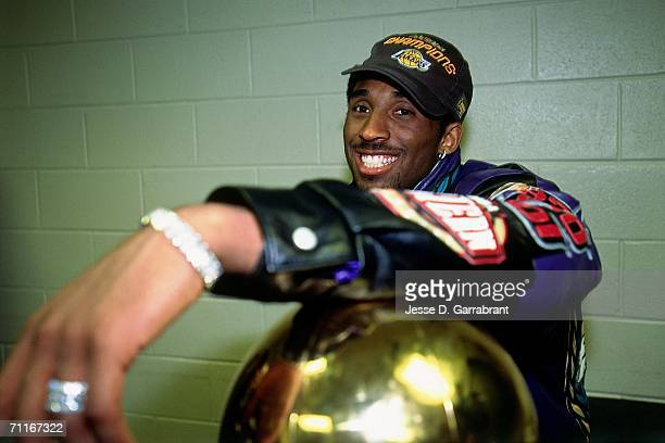 Kobe Bryant of the Los Angeles Lakers flashes a big smile after winning the NBA Championship by defeating the Philadelphia 76ers during game five of...