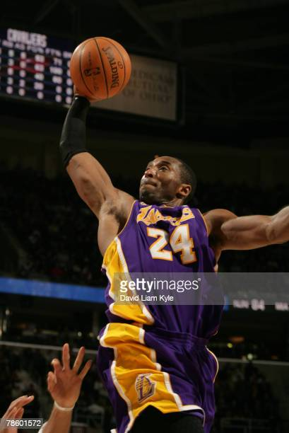 Kobe Bryant of the Los Angeles Lakers flies high for the dunk against the Cleveland Cavaliers at The Quicken Loans Arena December 17, 2007 in...