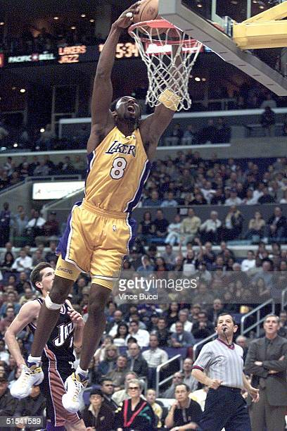 Kobe Bryant of the Los Angeles Lakers flies through the air to slam dunk the ball on a fast break in game against the Utah Jazz 04 February 2000 in...