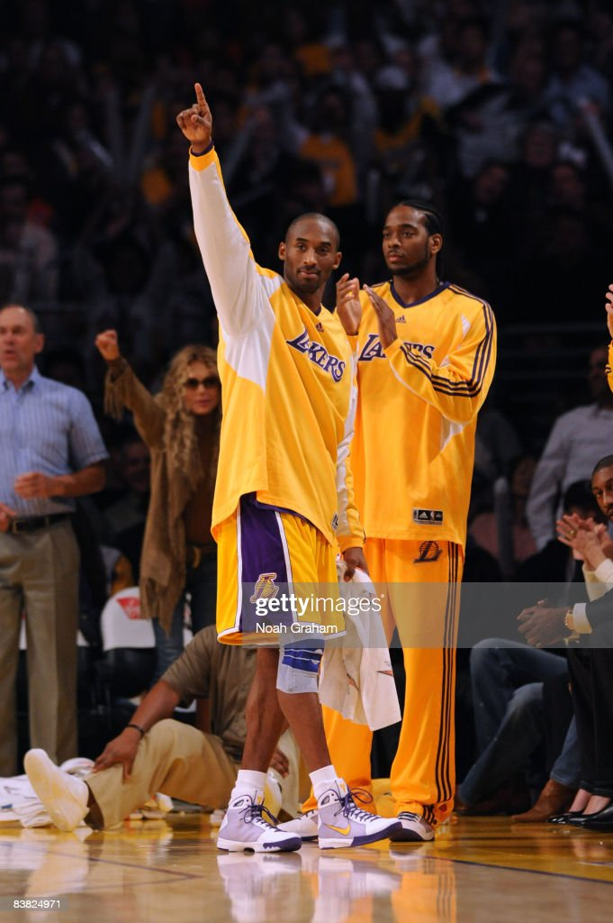 Kobe Bryant #24 of the Los Angeles Lakers gestures from the bench during the fourth quarter of the game against the New Jersey Nets at Staples Center on November 25, 2008 in Los Angeles, California.