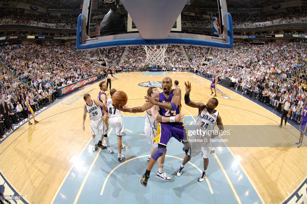 Kobe Bryant of the Los Angeles Lakers get fouled on the way to the basket by Kyrylo Fesenko of the Utah Jazz in Game Four of the Western Conference Semifinals during the 2010 NBA Playoffs at the EnergySolutions Arena on May 10, 2010 in Salt Lake City, Utah.