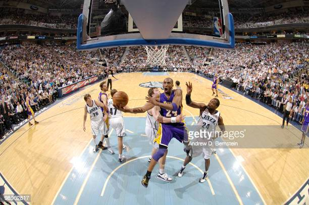 Kobe Bryant of the Los Angeles Lakers get fouled on the way to the basket by Kyrylo Fesenko of the Utah Jazz in Game Four of the Western Conference...