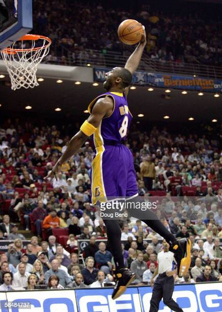 Kobe Bryant of the Los Angeles Lakers gets a breakaway dunk against the Orlando Magic at the TD Waterhouse Centre on December 23 2005 in Orlando...