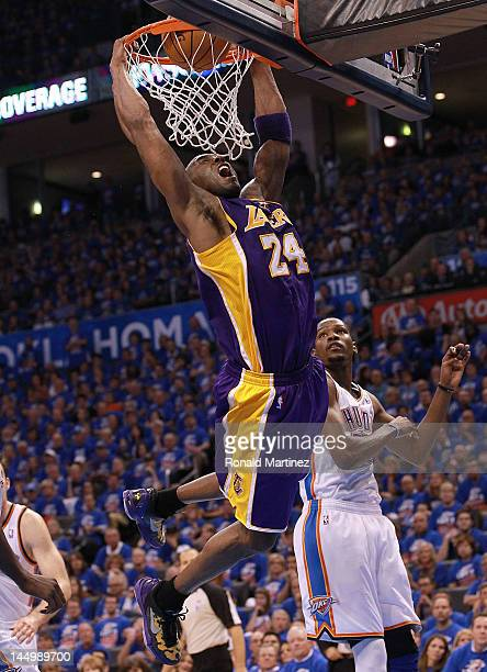 Kobe Bryant of the Los Angeles Lakers gets a slam dunk against the Oklahoma City Thunder during Game Five of the Western Conference Semifinals of the...