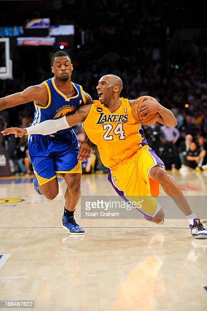 Kobe Bryant of the Los Angeles Lakers gets injured while driving against Harrison Barnes of the Golden State Warriors at Staples Center on April 12...