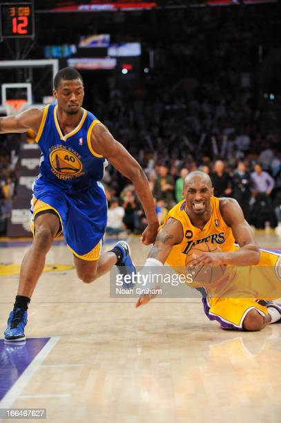 Kobe Bryant of the Los Angeles Lakers gets injured while driving against Harrison Barnes of the Golden State Warriors at Staples Center on April 12,...