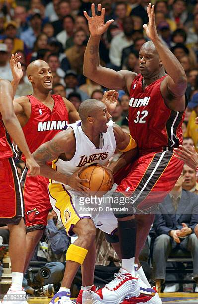 Kobe Bryant of the Los Angeles Lakers gets stopped in the lane by Shaquille O'Neal of the Miami Heat on December 25 2004 at the Staples Center in Los...