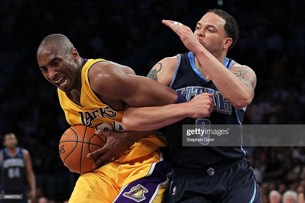 Kobe Bryant #24 of the Los Angeles Lakers gets tied up with Deron Williams #8 of the Utah Jazz in the fourth quarter during Game Two of the Western Conference Semifinals of the 2010 NBA Playoffs at Staples Center on May 4, 2010 in Los Angeles, California.