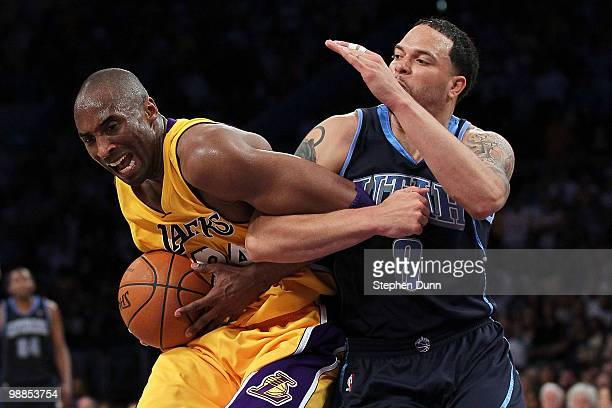 Kobe Bryant of the Los Angeles Lakers gets tied up with Deron Williams of the Utah Jazz in the fourth quarter during Game Two of the Western...
